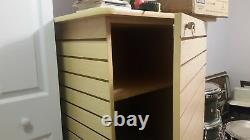 Maple four-sided slatwall retail display case with interior storage