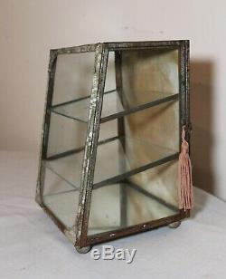 Rare antique glass ornate metal footed countertop store display show case