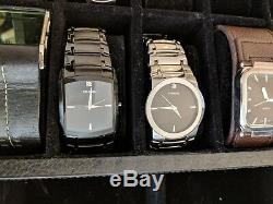 Set of Fossil Watches + Display Case. All in great condition and kept in storage