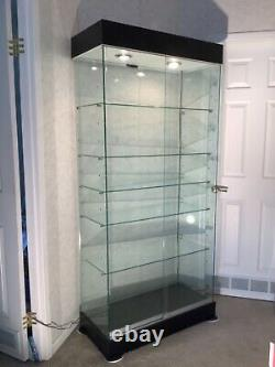 Used Glass Tower Display Showcase 15 shelf levels Store Fixture + Lights
